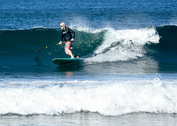 Photo of Carl Mahlstedt surfing with his SUP