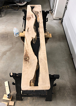 Photo of Live Edge River Table before the void is filled with epoxy