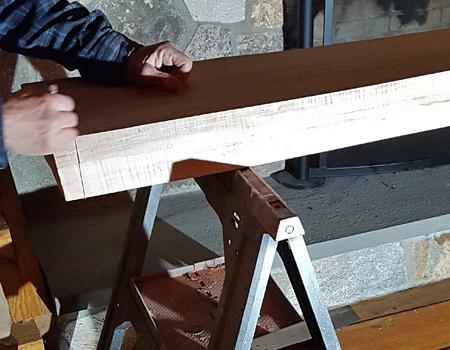 Photo of marking a mantle's length with a pencil
