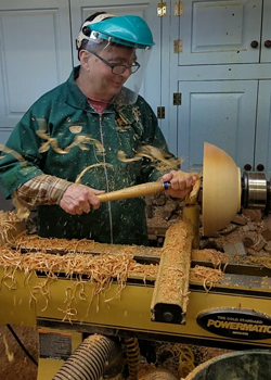 Photo of Claude Dupuis at the lathe