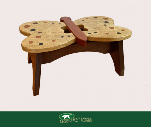 Photo of wooden child's stool in the shape of a butterfly