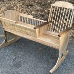 Photo of a maple granny cradle made by Peter
